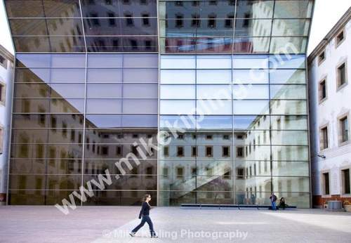 Barcelona Centre for Contemporary Culture, situated in El Raval, in the Ciutat Vella district of Barcelona, Cataunya, Spain - Barcelona, Catalunya, Spain, reflections, glass, glass, Centre for Contemporary Culture, museum, girl, student, walking,