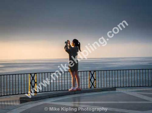 Tourist Photographing at Dawn on the Balcon de Europe, Nerja, Costa Del Sol, Spain,