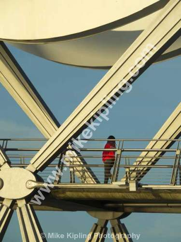 Detail, the Infiniti Bridge over the River Tees between Stockton and Thornaby, Cleveland. - Cleveland, Stockton on Tees, Infiniti, Bridge, River, Tees, dual, tied arch bridge, bowstring bridge, Engineering, Red, Walker,
