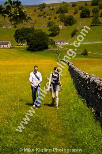 Couple walking in a buttercup meadow, swaledale - Yorkshire, Swaledale, buttercup, meadow, couple, walking